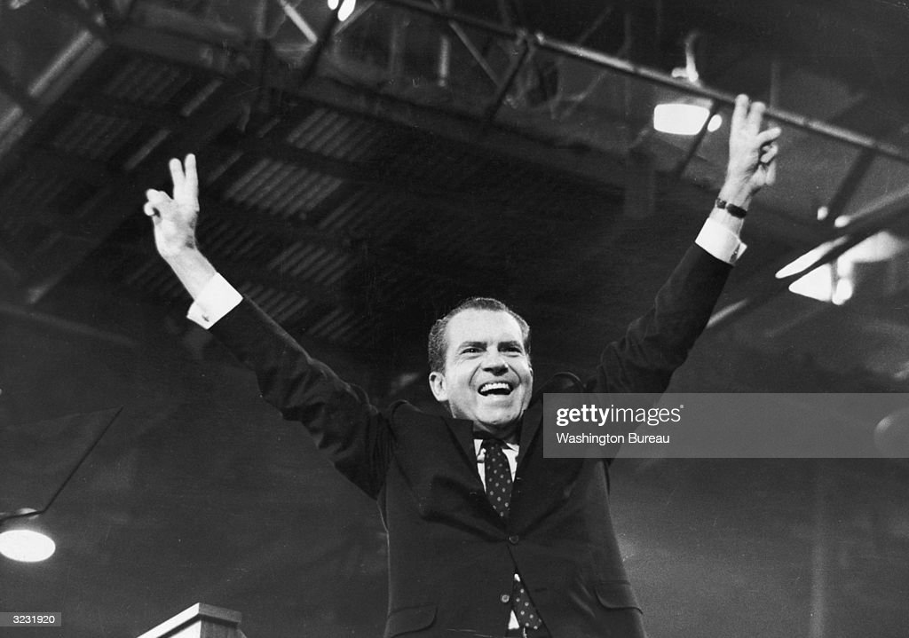 American politician <a gi-track='captionPersonalityLinkClicked' href=/galleries/search?phrase=Richard+Nixon&family=editorial&specificpeople=92456 ng-click='$event.stopPropagation()'>Richard Nixon</a> (1913-1994) gives the 'V' for victory sign after receiving the presidential nomination at the Republican National Convention, Miami, Florida.