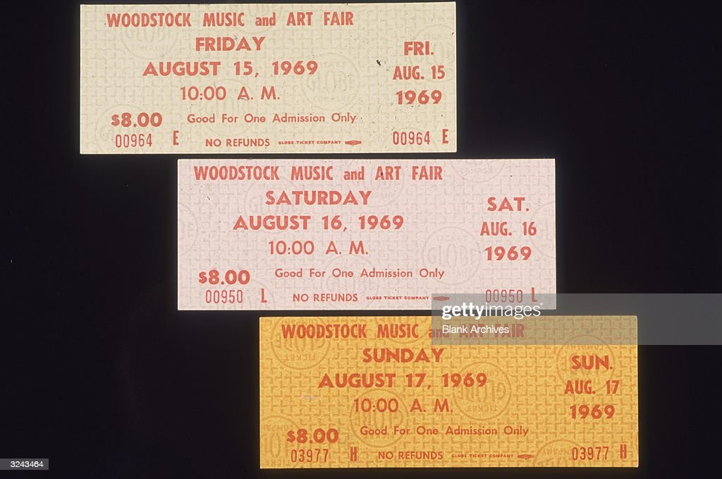 Closeup still life of three single-day admission tickets for the Woodstock Music and Arts Fair in Bethel, New York.