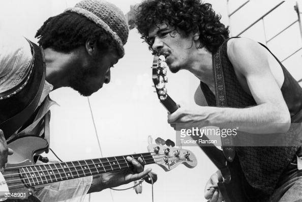 Mexicanborn guitarist Carlos Santana and bassist David Brown perform with the group Santana at the Woodstock Music Festival in Bethel New York