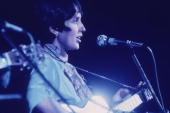 Profile of American folk musician Joan Baez singing and playing the guitar at the Woodstock Music Festival Bethel New York