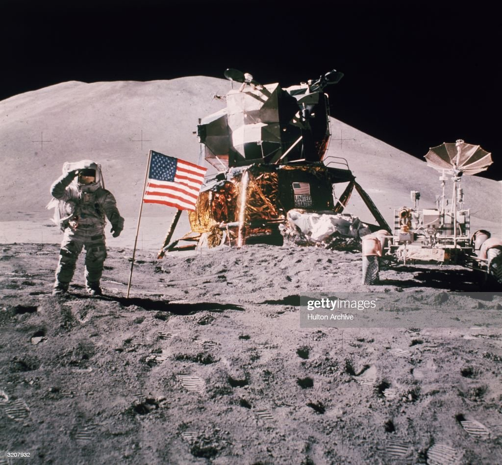 Astronaut James Irwin salutes in front of the landing module of the Apollo 15 on the moon. (Photo by Hulton Archive/Getty Images)