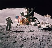 Astronaut James Irwin salutes in front of the landing module of the Apollo 15 on the moon