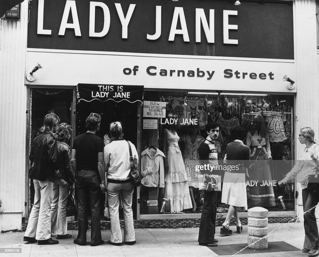Window shoppers looking in the Lady Jane clothes shop in Carnaby Street, London.