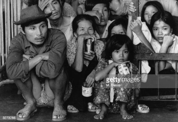 The faces of some Vietnamese Boat People held at the Government Dock yard in Hong Kong