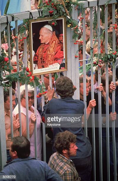 Members of the Trade Union Solidarity who are on strike at the Lenin Shipyard in Gdansk adorn the shipyard gates with flowers and pictures of the...