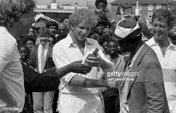 14 August 1984 The Oval Cricket 5th Test England v West Indies England captain David Gower inspects a bottle of Thunderbird wine offered by a West...