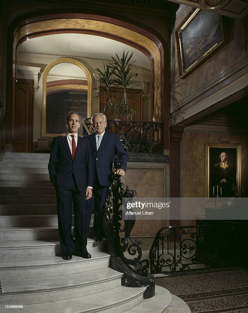 August 1986 Prince Rainier and Prince Albert of Monaco pose on the steps of the grand staircase in their palace