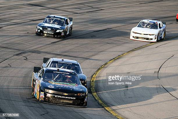 Michael McDowell driver of the No 20 Pizza Ranch Toyota leads a pack of cars during the 6th Annual US Cellular 250 presented by New Holland NASCAR...