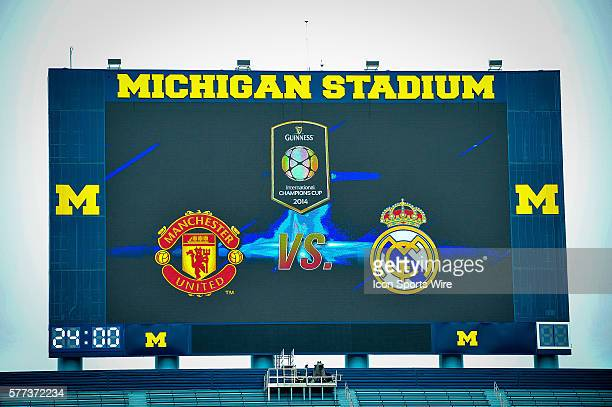 The Michigan Stadium scoreboard shows the logos of Real Madrid v Manchester United before the Real Madrid v Manchester United match Saturday...