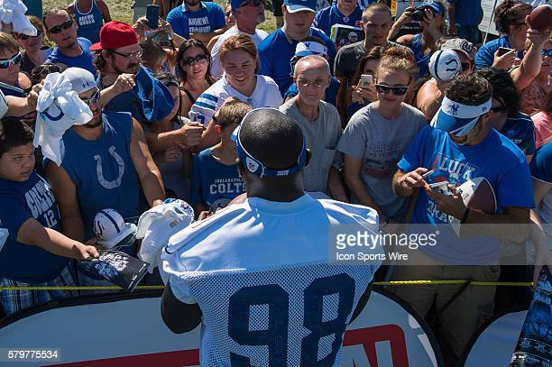 Indianapolis Colts outside linebacker Robert Mathis signs autographs for fans after the Indianapolis Colts Training Camp at Anderson University in...