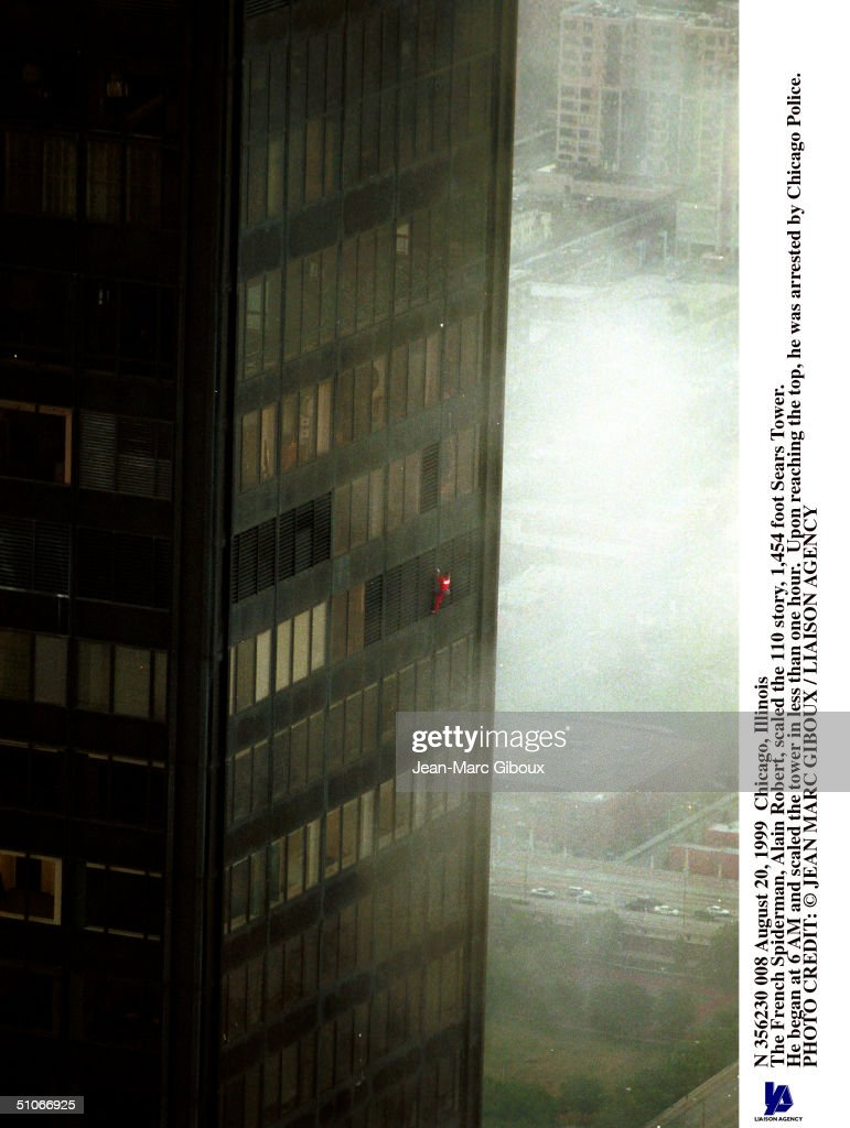 August 20, 1999 Chicago, Illinois The French Spiderman, Alain Robert, Scaled The 110 Story, 1,454 Foot Sears Tower. He Began At 6 Am And Scaled The Tower In Less Than One Hour. Upon Reaching The Top, He Was Arrested By Chicago Police.