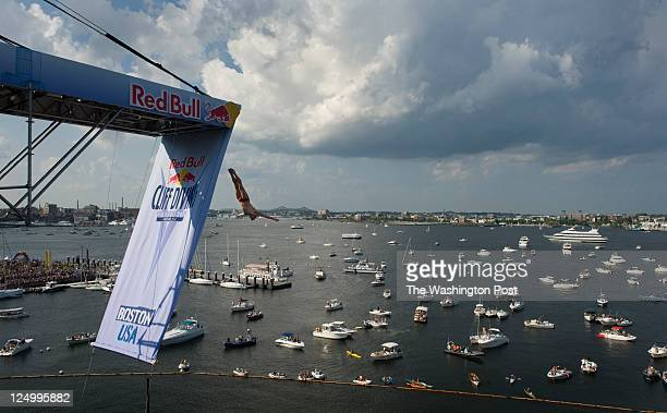 US Cliff Diver Kent DeMond takes off from the platform on top of the Institute of Contemporary Art during 2nd round action Red Bull Cliff Diving...