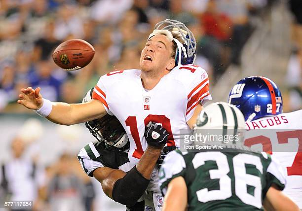 New York Giants quarterback Eli Manning gets tackled and looses his helmet during first half of the New York Giants 3116 win over the New York Jets...