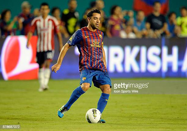 FC Barcelona midfielder Xavi Hernandez plays against Chivas De Guadalajara at Sun Life Stadium Miami Florida in Chivas' 41 victory in the Herbalife...
