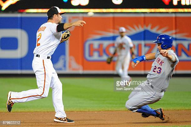 Baltimore Orioles shortstop JJ Hardy completes a double play forcing out New York Mets left fielder Michael Cuddyer at Orioles Park at Camden Yards...
