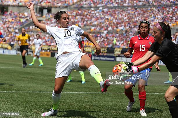 Dinnia Diaz grabs the ball off of the foot of Carli Lloyd as Cristin Granados trails the play The United States Women's National Team played the...