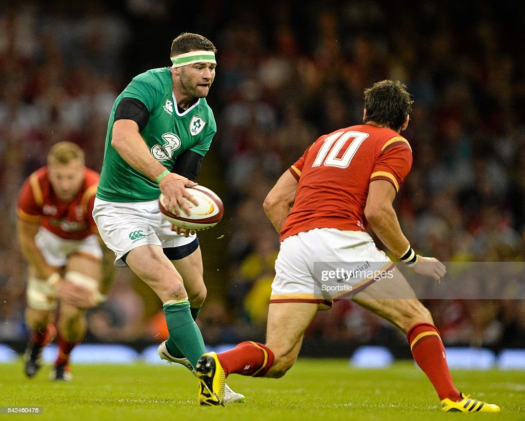 8 August 2015 Fergus McFadden Ireland in action against James Hook Wales Rugby World Cup WarmUp Match Wales v Ireland Millennium Stadium Cardiff...