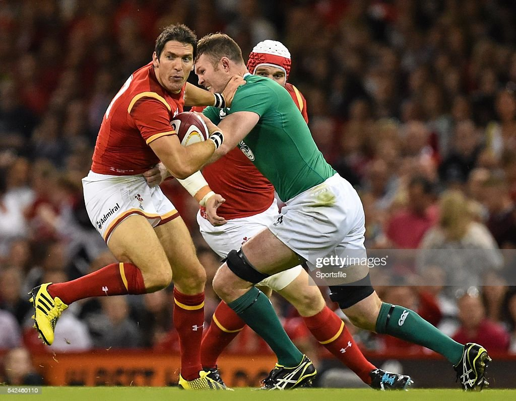 8 August 2015 James Hook Wales is tackled by Donnacha Ryan Ireland Rugby World Cup WarmUp Match Wales v Ireland Millennium Stadium Cardiff Wales...