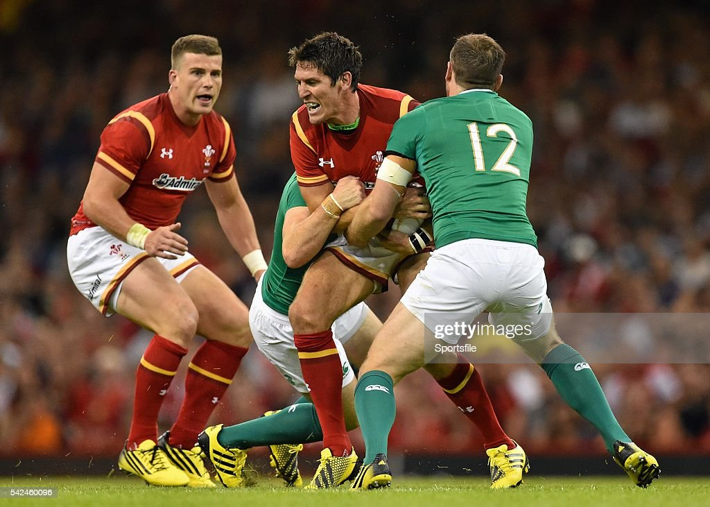 8 August 2015 James Hook Wales is tackled by Eoin Reddan left and Darren Cave Ireland Rugby World Cup WarmUp Match Wales v Ireland Millennium Stadium...