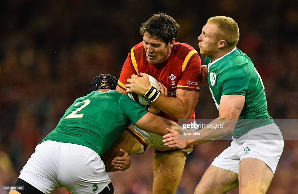 8 August 2015 James Hook Wales is tackled by Richardt Strauss left and Keith Earls Ireland Rugby World Cup WarmUp Match Wales v Ireland Millennium...