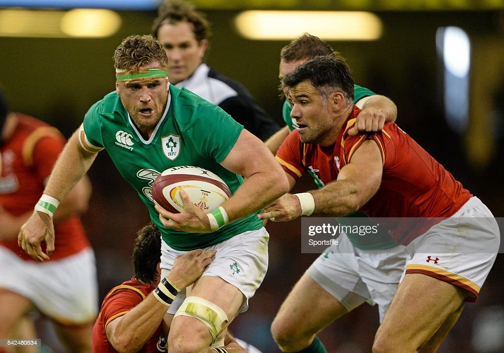 8 August 2015 Jamie Heaslip Ireland is tackled by James Hook and Mike Phillips Wales Rugby World Cup WarmUp Match Wales v Ireland Millennium Stadium...