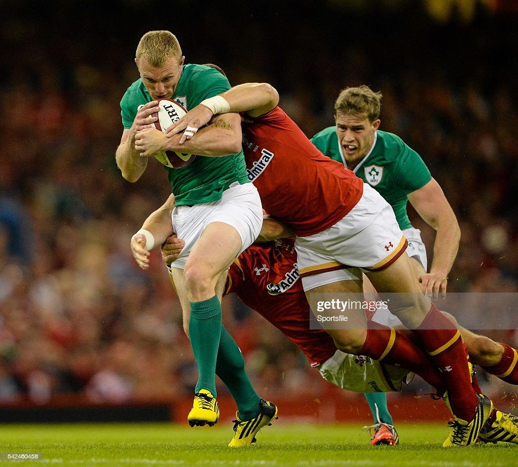 8 August 2015 Keith Earls Ireland is tackled by James Hook and Scott Williams Wales Rugby World Cup WarmUp Match Wales v Ireland Millennium Stadium...
