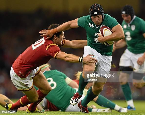 8 August 2015 Richardt Strauss Ireland is tackled by James Hook Wales Rugby World Cup WarmUp Match Wales v Ireland Millennium Stadium Cardiff Wales...