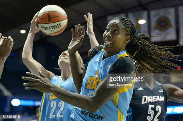 Chicago Sky forward Jessica Breland reacts as Chicago Sky guard Courtney Vandersloot attempts a shot during a WNBA game between the Atlanta Dream and...