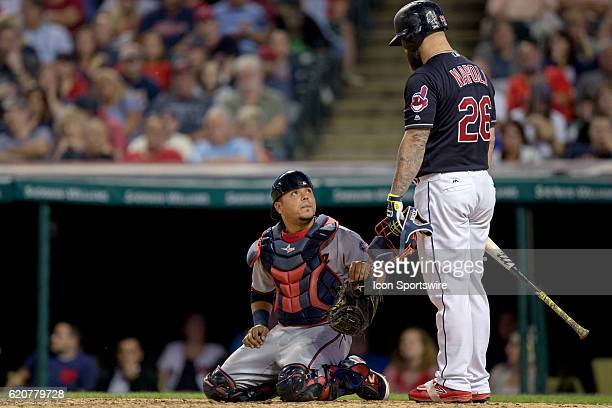 Cleveland Indians First base Mike Napoli [6085] checks on Minnesota Twins Catcher Juan Centeno [10505] after Centeno was hit with a foul tip during...