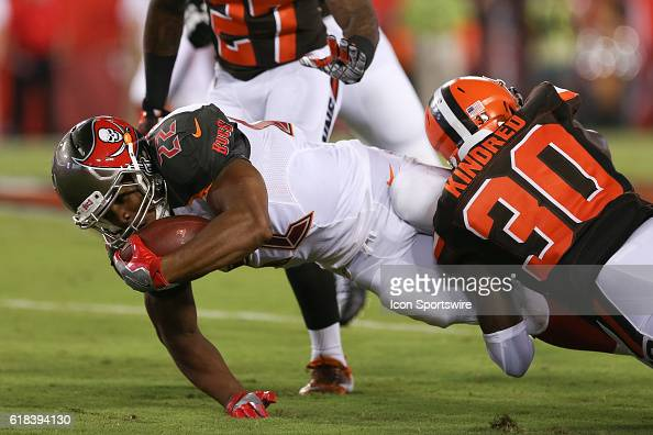 Tampa Bay Buccaneers running back Doug Martin is brought down by Cleveland Browns defensive back Derrick Kindred after picking up the first down...