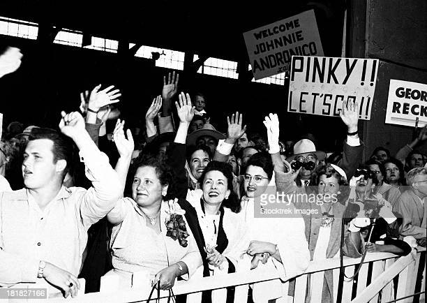 August 23, 1953 - The families of the returning POW's waving and greeting the ship the General Nelson M. Walker as it docks at Fort Mason, California.