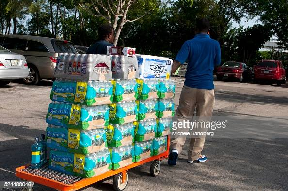 August 23 2012 Person buying beverages food and supplies in preparation of Storm Isaac South Florida prepares for Storm Isaac