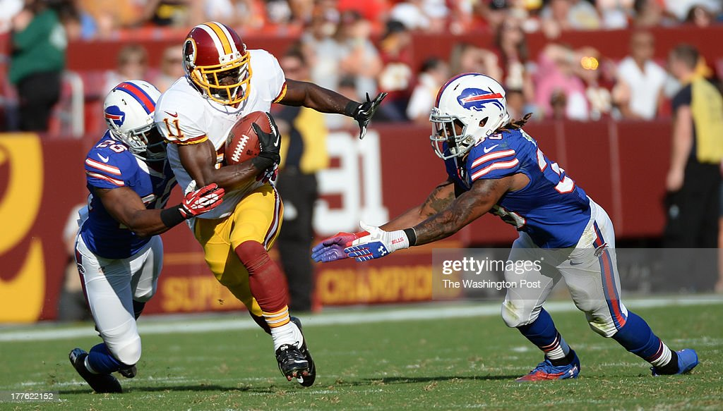 Washington Redskins wide receiver Aldrick Robinson (11) gains yards after a second quarter reception against the Buffalo Bills on August 24, 2013 in Landover, MD