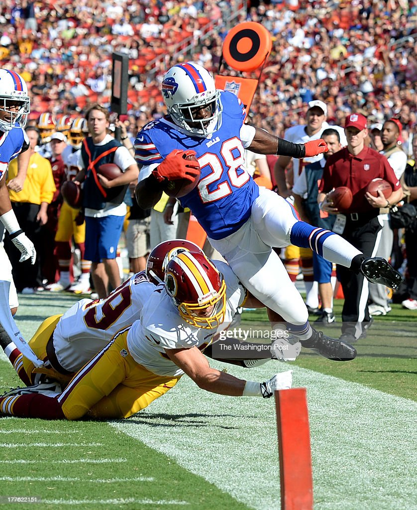 Washington Redskins strong safety Reed Doughty (37) knocks Buffalo Bills running back C.J. Spiller (28) out of bounds inside the 10 yard line during first quarter action on August 24, 2013 in Landover, MD