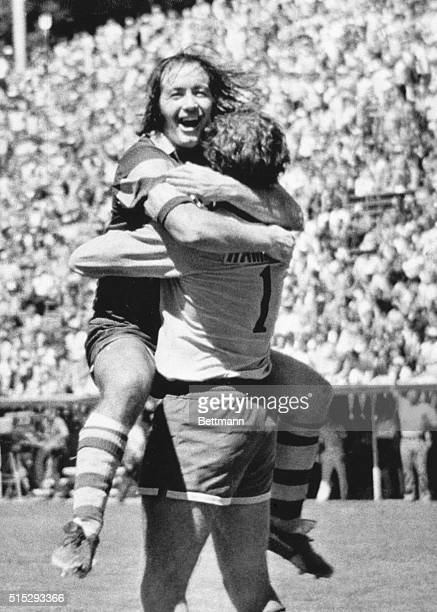 August 25 1975 San Jose California John Boyle Captain of the Tampa Bay Rowdies surrounds his goalkeeper Paul Hammond in a victory hug after a 20...