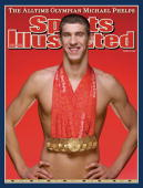 Swimming 2008 Summer Olympics Portrait of USA Michael Phelps posing with eight gold medals he won during Beijing Games Phelps holds the records for...