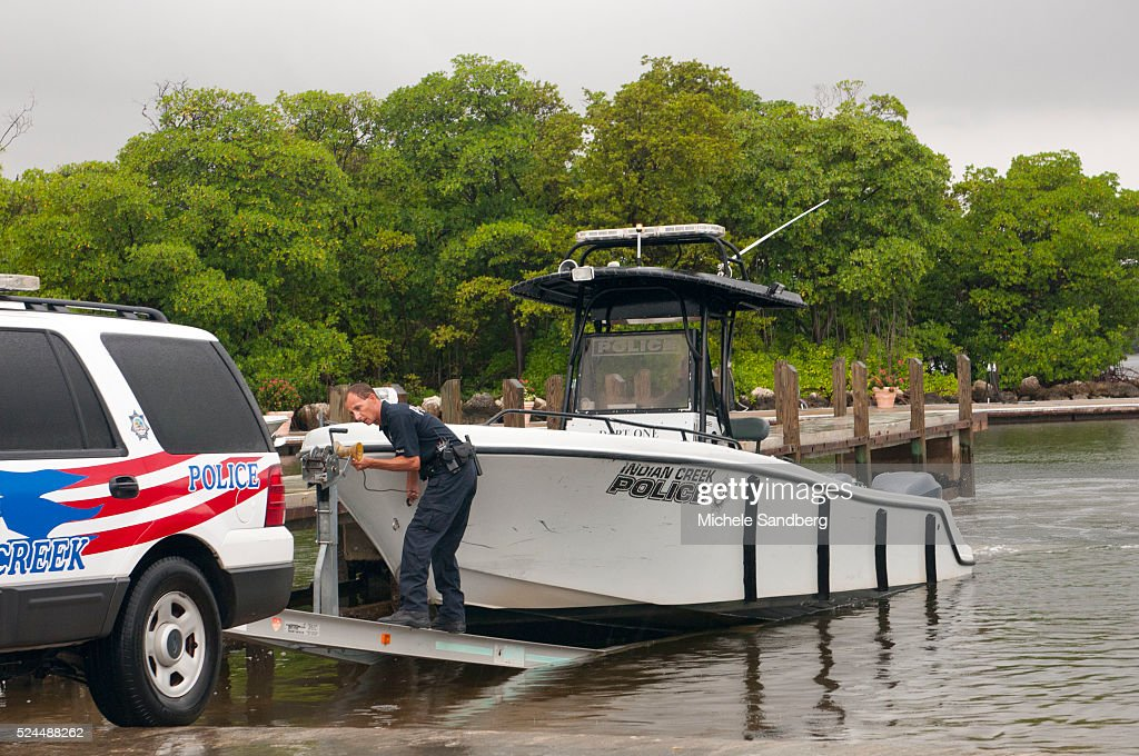 August 25 2012 OFFICER MARTINEZ AND OFFICER SULLIVAN of station Indian Creek remove a police boat from the water as Florida prepares for Hurricane...