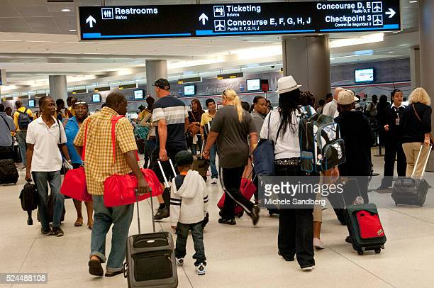 August 25 2012 People Wait In Line To Depart Miami International Airport As Hurricane Isaac Approaches Florida