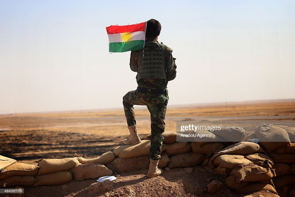 August 25, 2014 dated pictures show Peshmerga forces' ongoing progression to fight against army forces led by Islamic State (IS) and seize to regain areas in Mosul. A Peshmerga takes position to fight against IS in Al-Bakir neighborhood of Mosul, Iraq on August 25, 2014.