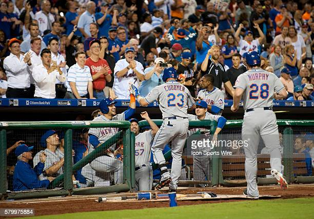 New York Mets First base Michael Cuddyer is greeted in the dugout after hitting a home run during the game between the New York Mets and Philadelphia...