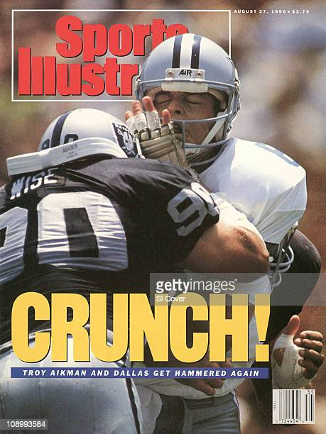 Football Dallas Cowboys QB Troy Aikman in action hit by Los Angeles Raiders Mike Wise during preseason game at Los Angeles Memorial ColiseumLos...