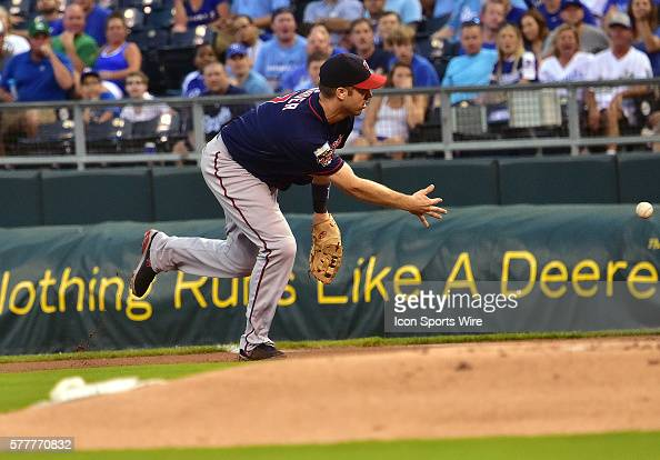 Minnesota Twins' first baseman Joe Mauer throws to Minnesota Twins' starting pitcher Phil Hughes covering first for an out during a major league...