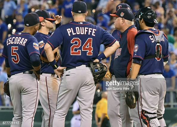 Twins team members talk with Minnesota Twins' starting pitcher Phil Hughes during a break during a major league baseball game between the Minnesota...