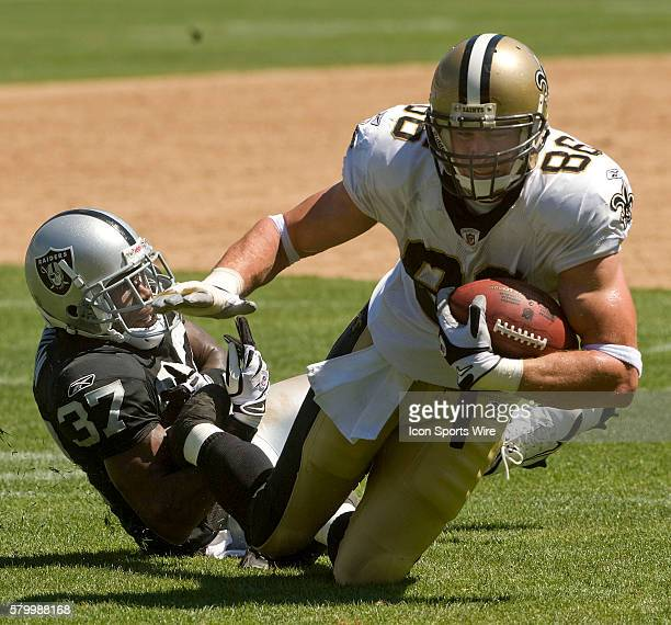 Oakland Raiders cornerback Chris Johnson trips up New Orleans Saints tight end Buck Ortega on Saturday August 29 2009 at Alameda County Coliseum in...