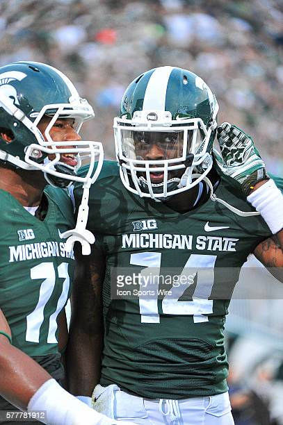 Michigan State Spartans quarterback Colar Kuhns congratulates Michigan State Spartans wide receiver Tony Lippett on his long touchdown reception in...