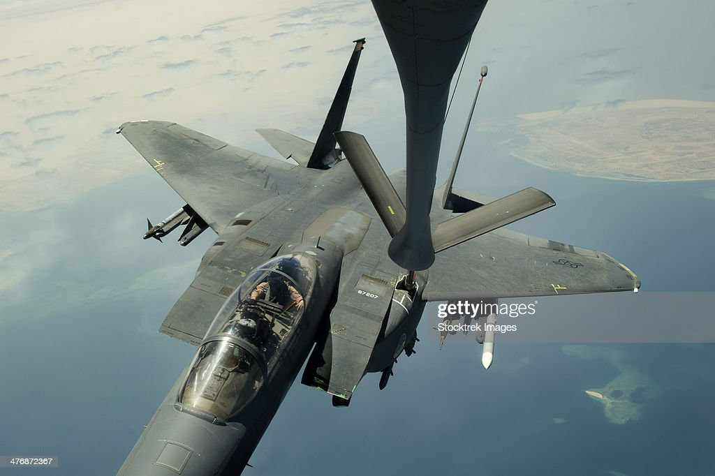 August 30, 2013 - An F-15E Strike Eagle receives fuel from a KC-135R Stratotanker during a mission over the Persian Gulf.
