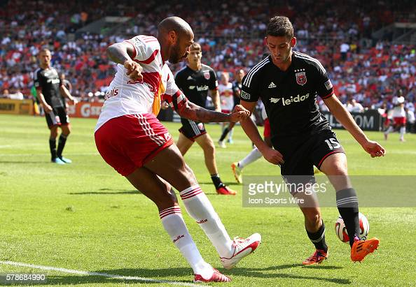 Thierry Henry of New York Red Bulls slips the ball through the legs of Steve Birnbaum of DC United during an MLS match at RFK Stadium in Washington...