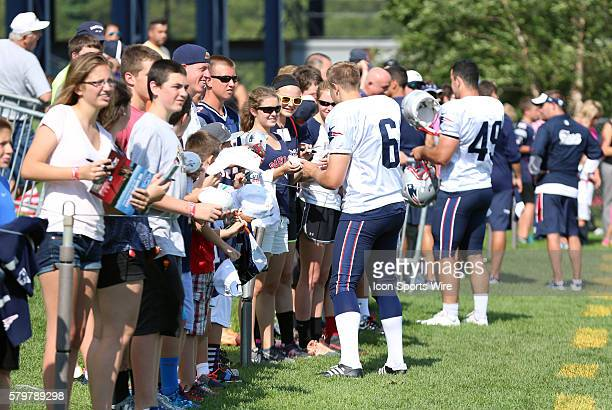 New England Patriots punter Ryan Allen and New England Patriots safety Joe Cardona sign autographs after New England Patriots training camp