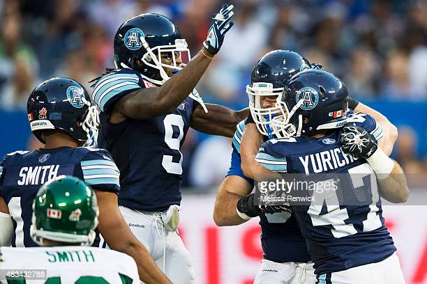 TORONTO ON August 8 Brett Smith breaks free from a sac attempt by Ricky Foley during the first half action of CFL season play between the Toronto...
