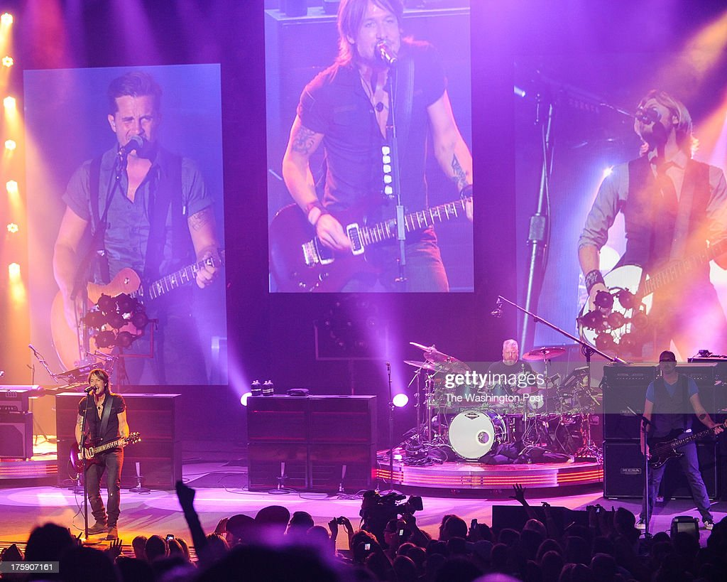 COLUMBIA, MD - August 8th, 2013 - Keith Urban (left) performs at Merriweather Post Pavilion as part of his Light The Fuse Tour. Urban's eighth studio album, Fuse, will be released in September.